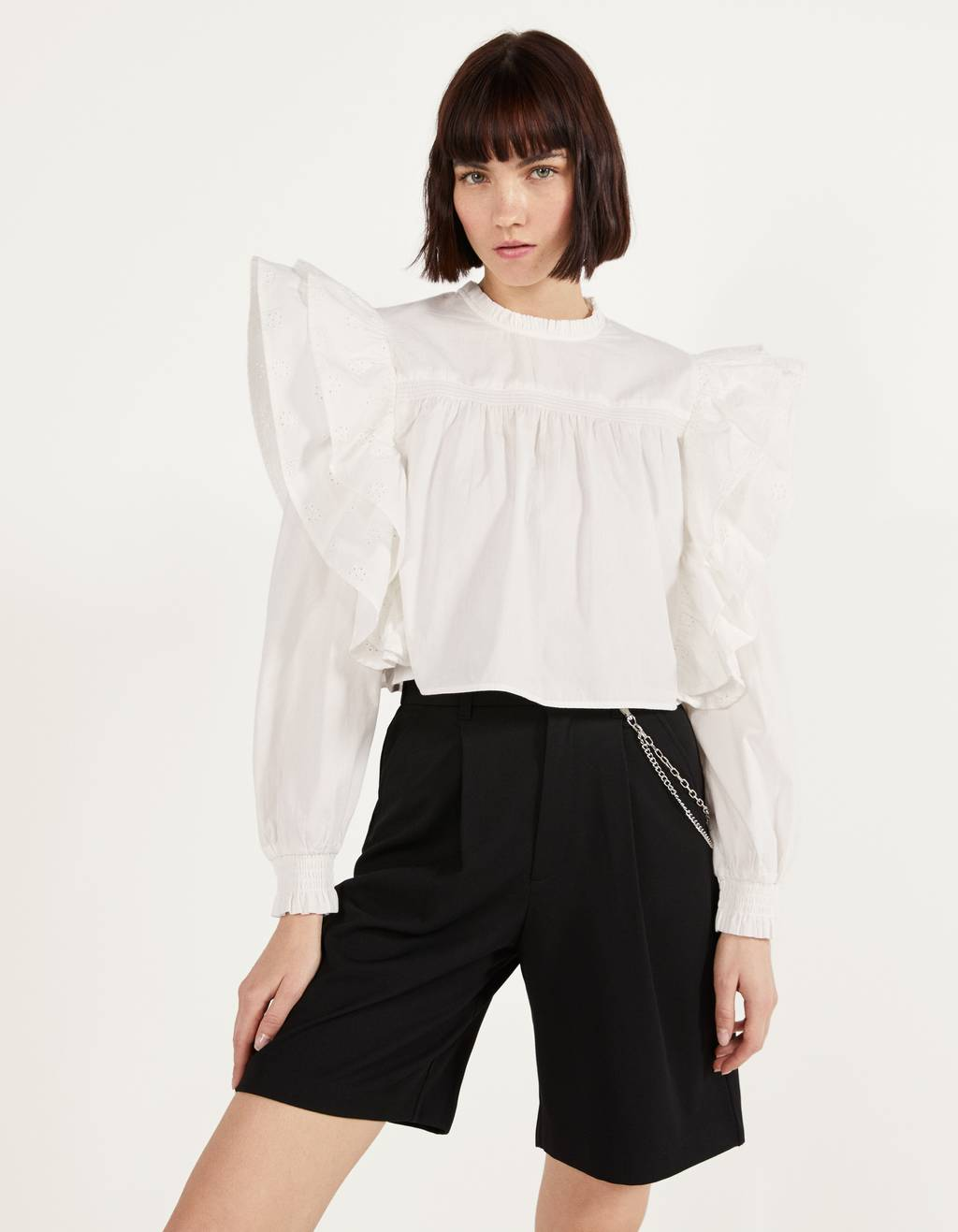 Ruffled blouse with Swiss embroidery