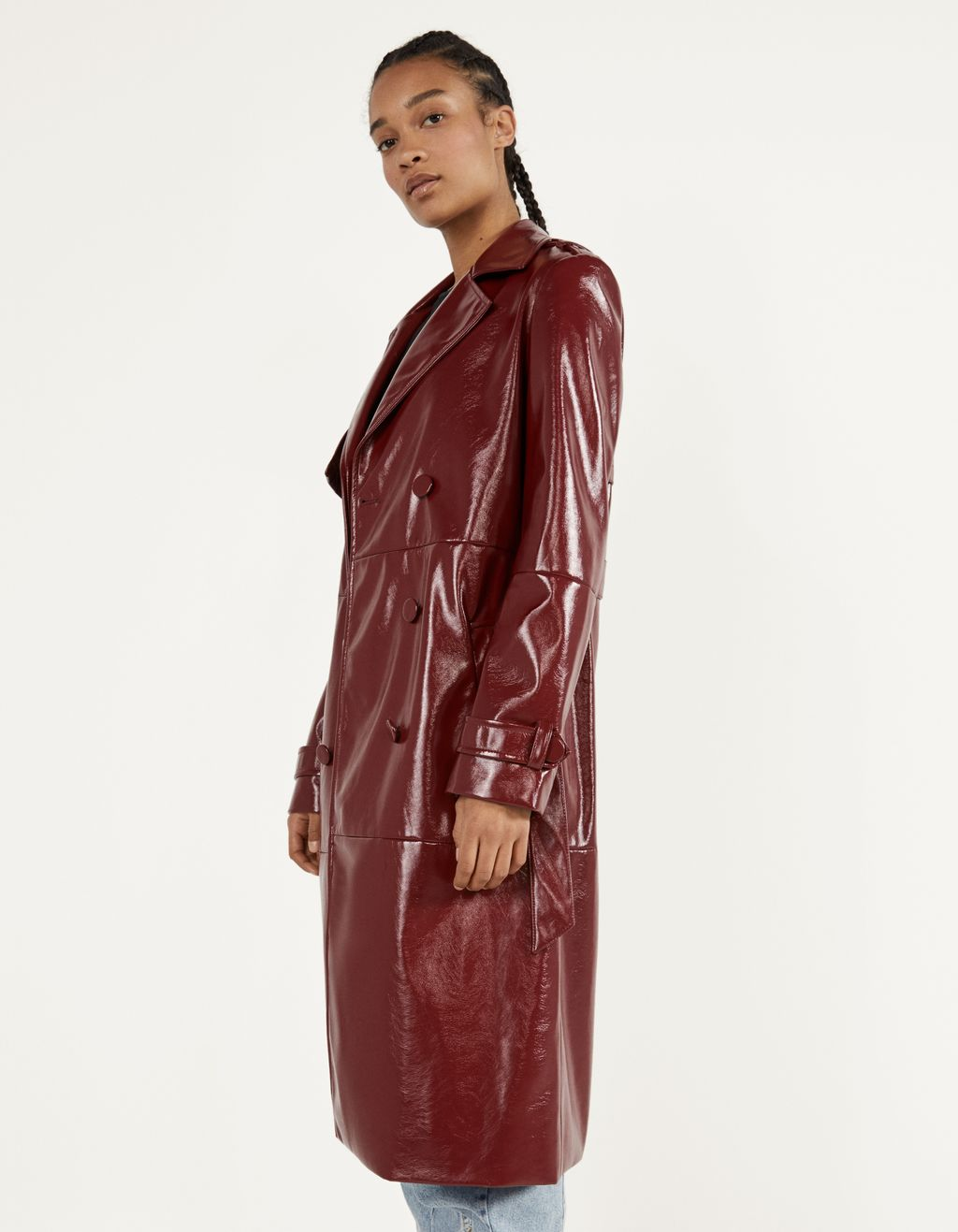Double-breasted vinyl trench coat