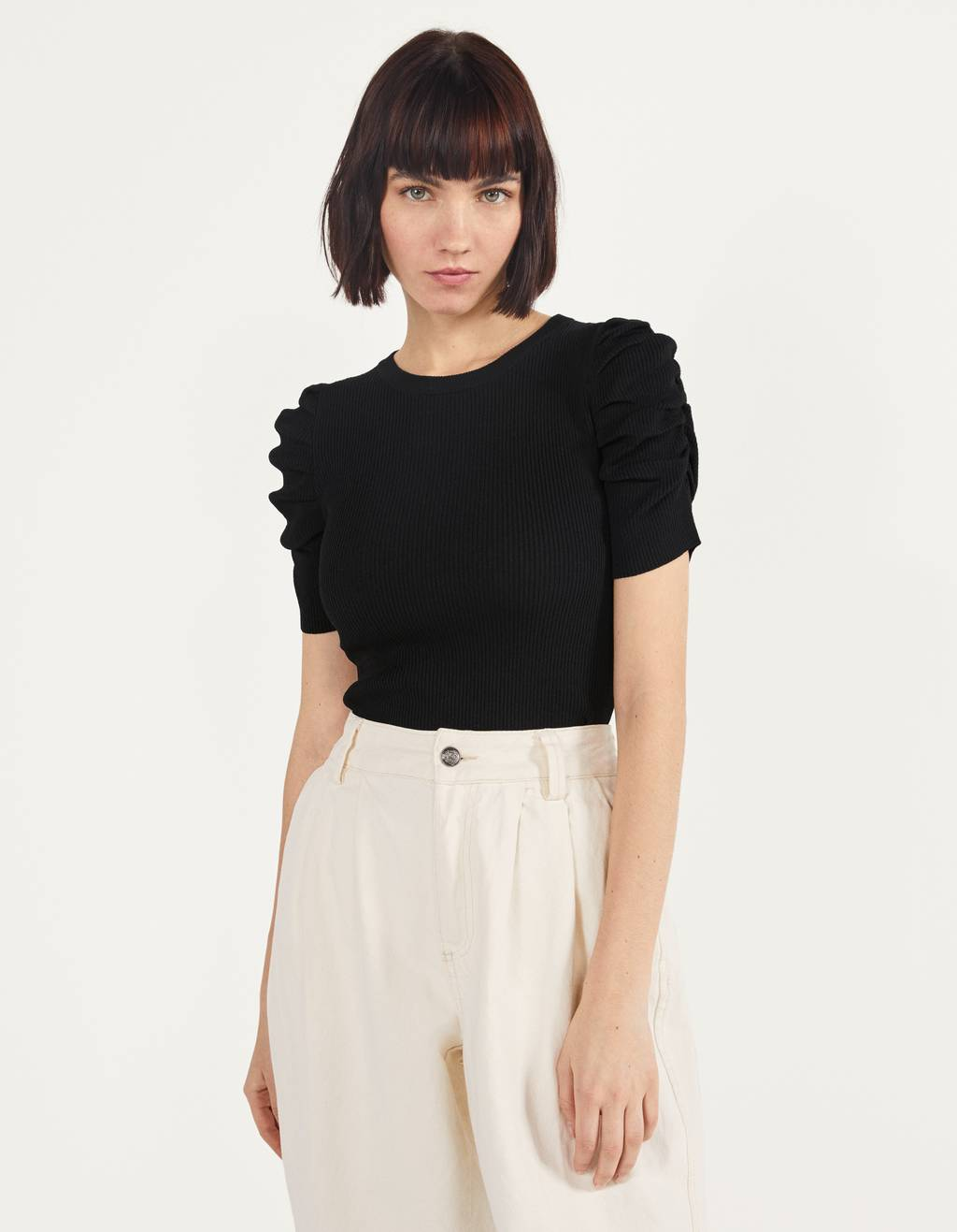 Knit top with voluminous sleeves