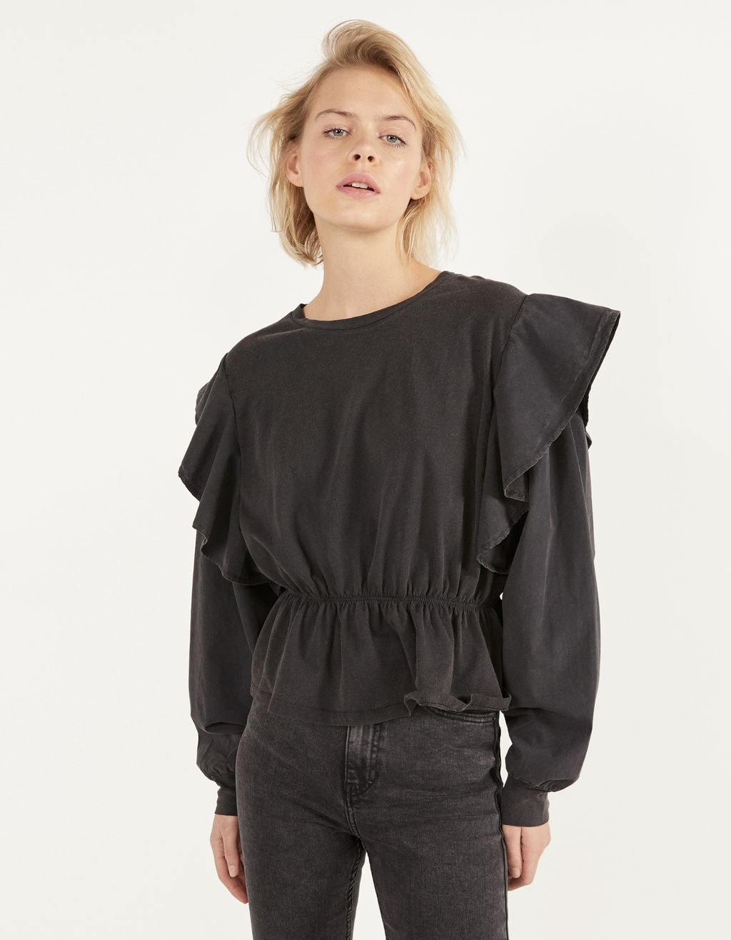 Top with ruffles and ruching