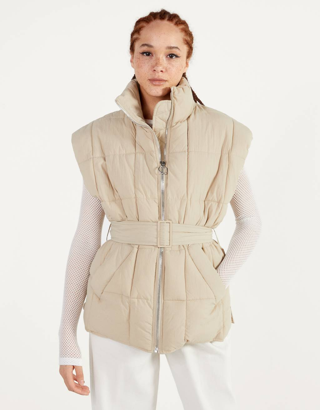 Quilted vest with belt