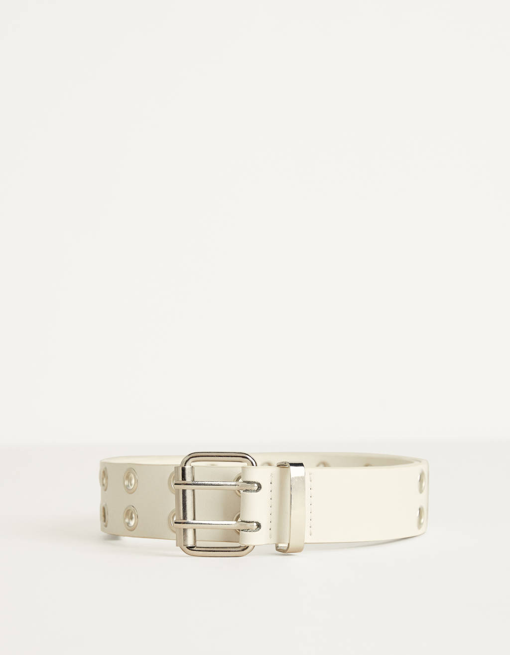 Belt with metal eyelets