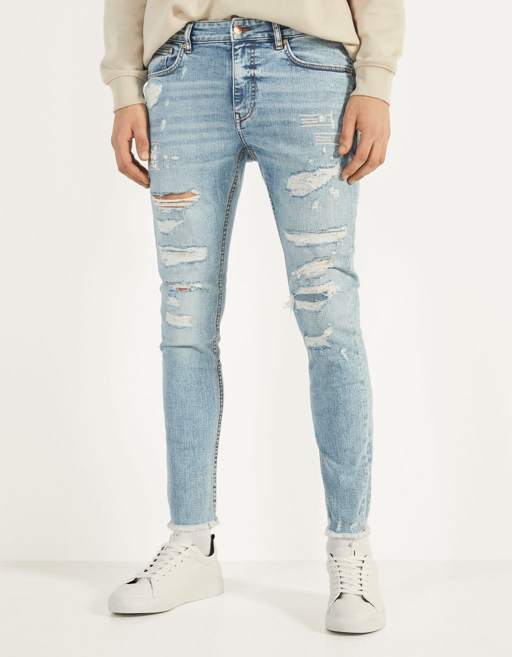 Jeans Super Skinny Fit con rotos