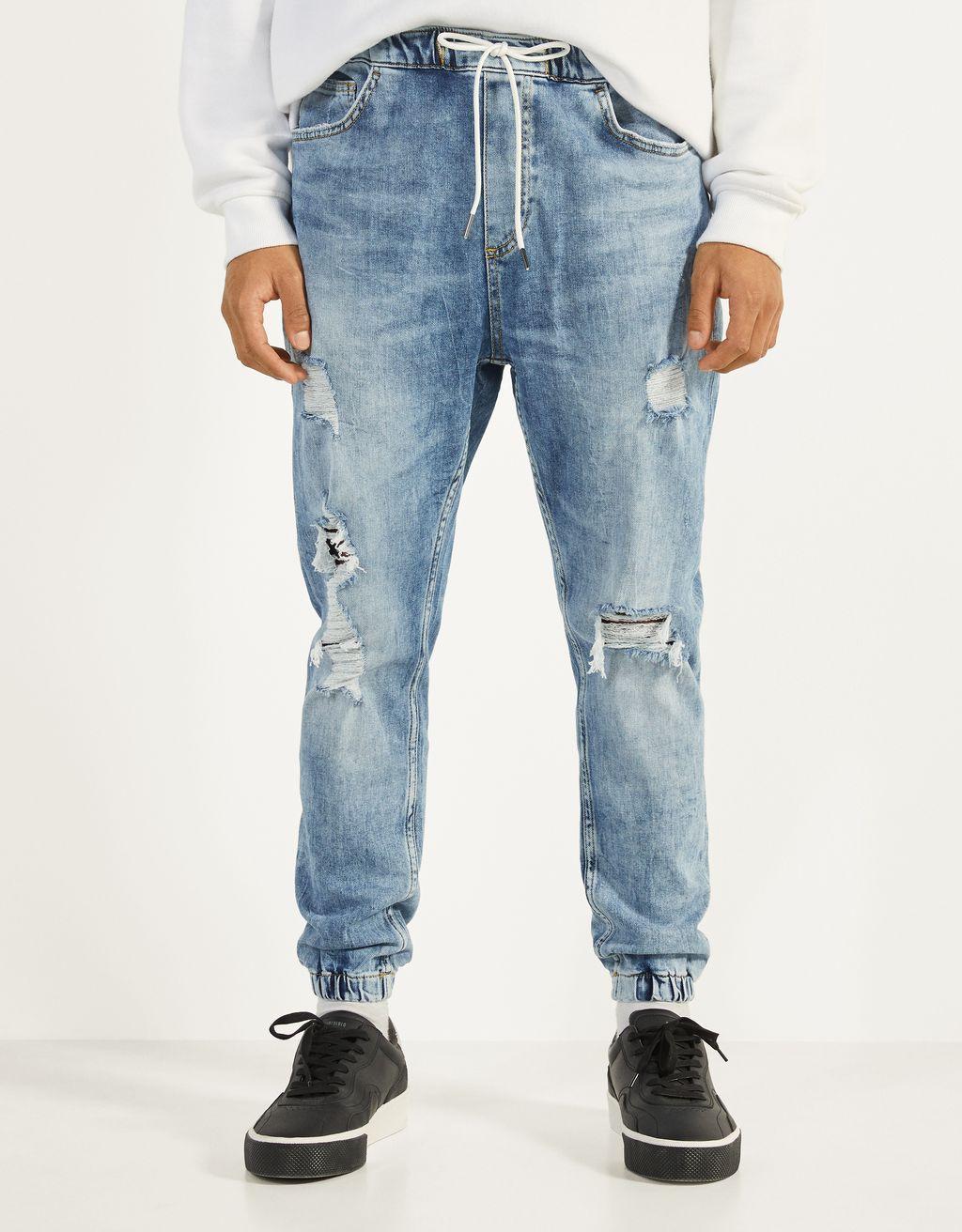 Jeans jogger com rasgões