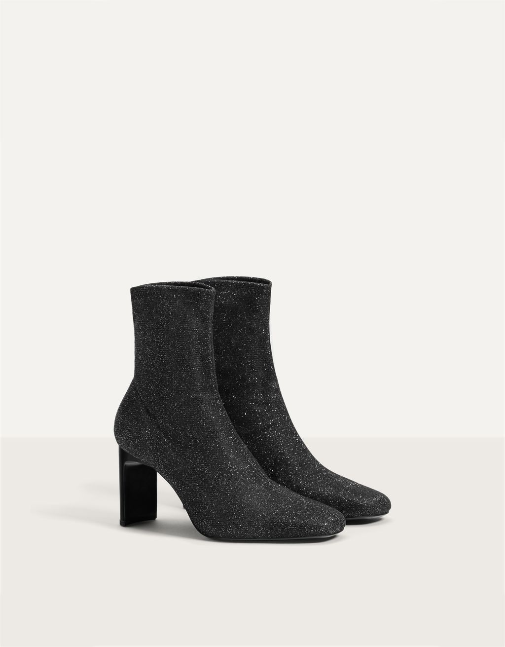 Sock-style high-heel ankle boots with shimmer