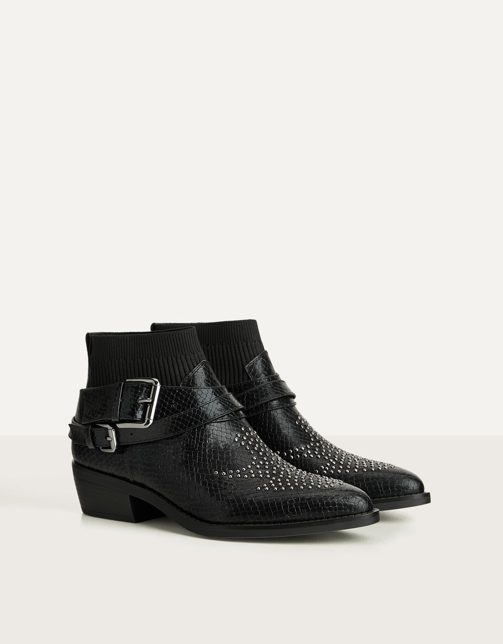 Embossed sock-style ankle boots with studs
