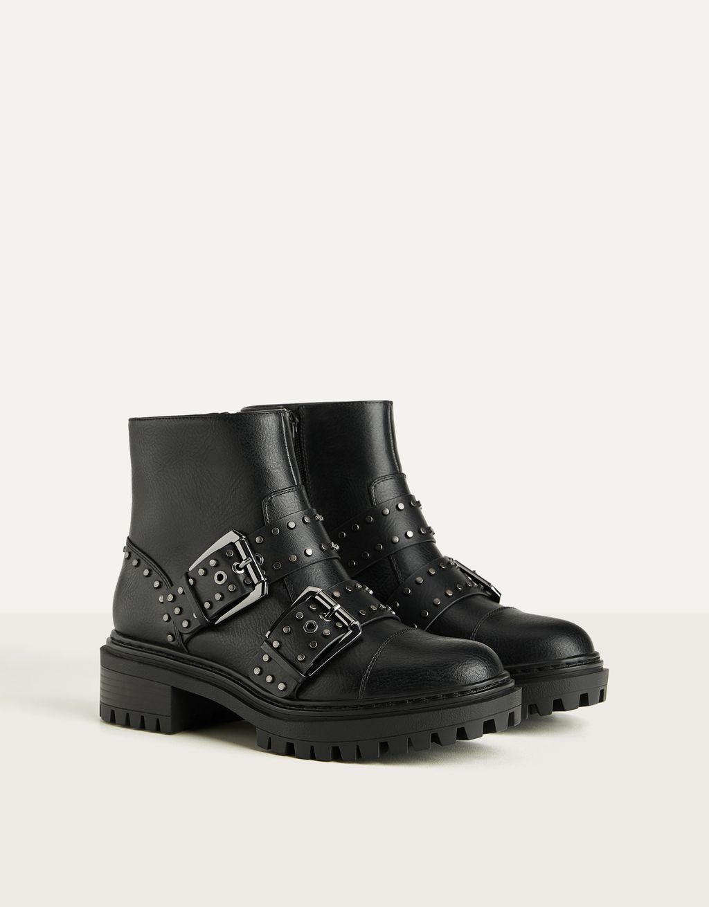 Flat ankle boots with buckle and stud details
