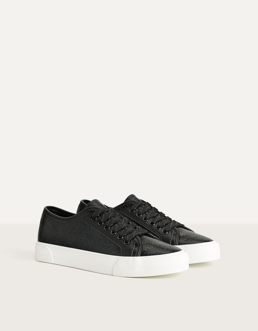 Embossed animal print sneakers
