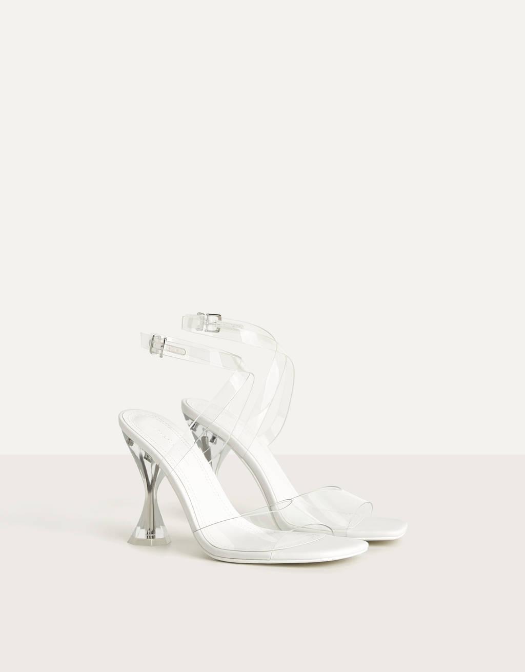 High-heel sandals with vinyl straps and methacrylate heels.